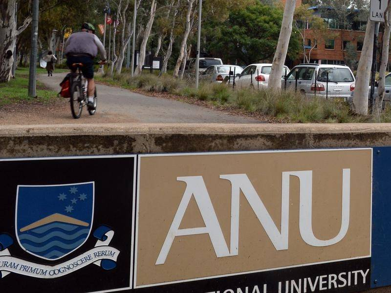 The ANU will cut 215 staff in a bid to further slash costs, after about 250 voluntary redundancies.